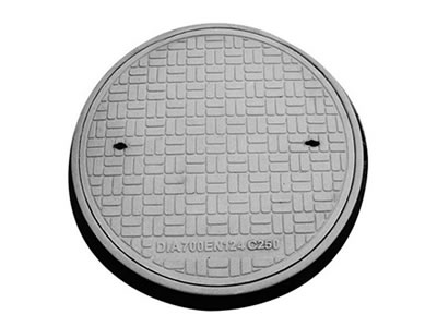 A gray round FRP manhole cover which diameter is 700 mm, the cover with many strips, two drainage holes and frame.