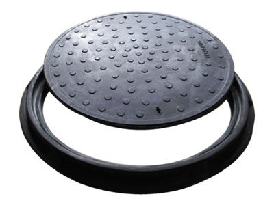A black round FRP manhole cover with many round shapes, two drainage holes and frame.