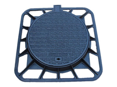A round cast iron manhole cover which has many n symbols, a drainage hole, a projection joint and square frame.