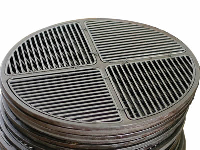 A round cast iron grating includes four parts which is symmetrical.
