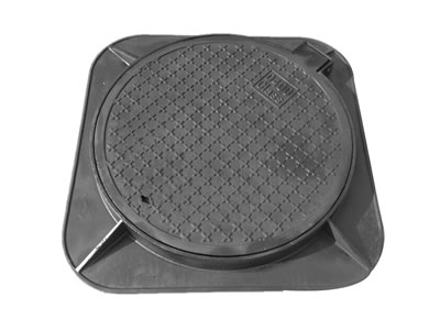 A round cast iron manhole cover with a joint, a drainage hole, cross shapes and square frame that has four stems.