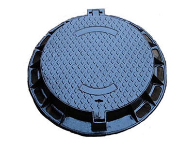 A round cast iron manhole cover with diamond blocks, projected joint, a drainage hole and frame.