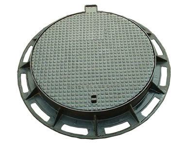 A round cast iron manhole cover with a projected joint, a drainage hole, many square blocks and frame.