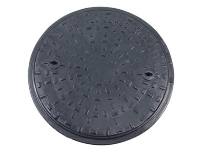 A round cast iron manhole cover with rectangle blocks, two drainage holes and frame.