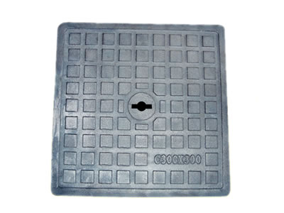 A square cast iron manhole cover which is 300 mm width, has a drainage hole and square blocks.