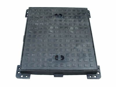A rectangle ductile iron manhole cover with square blocks design on the surface, two handles and four feet.