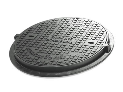 A round cast iron manhole cover which can bear 1.5 tons, has two drainage holes and many square blocks.