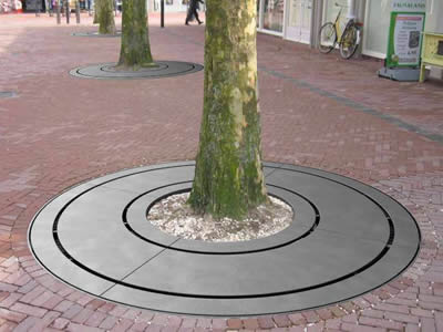 A round cast iron tree grating with three ring shape, and middle ring is wide.