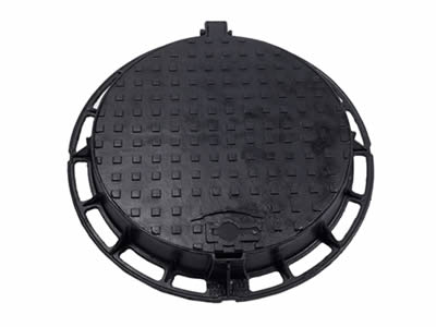 A round ductile iron manhole cover with square blocks, a drainage hole, a projection and round frame.