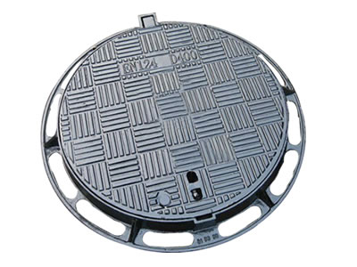 A round cast iron manhole cover with strips which five strips form a square.