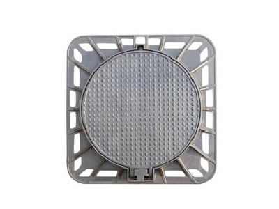 A round cast iron manhole cover with a projected joint, diamond blocks and square frame.