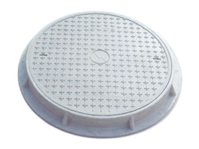 A gray round FRP manhole cover with many cross shapes, two drainage holes and frame; frame has many stems on it.