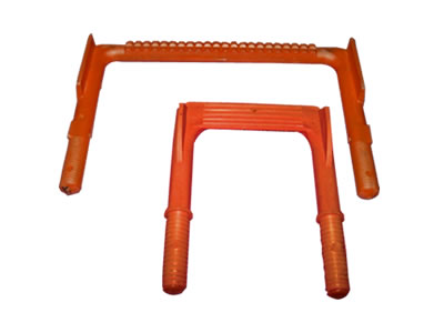Two orange footrests in wide and narrow with skid projections and screw thread.