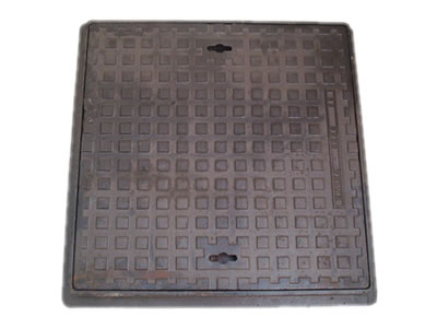 A rectangle cast iron manhole cover with frame, square blocks and two drainage holes.