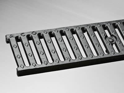 A rectangle ductile iron grating with one row drainage holes, four row round projections and bitumen coating.